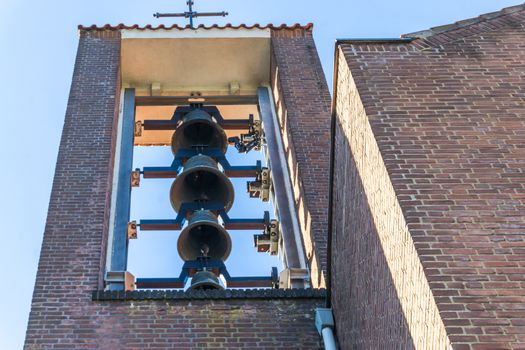group of church bells hanging in a church tower for ringing