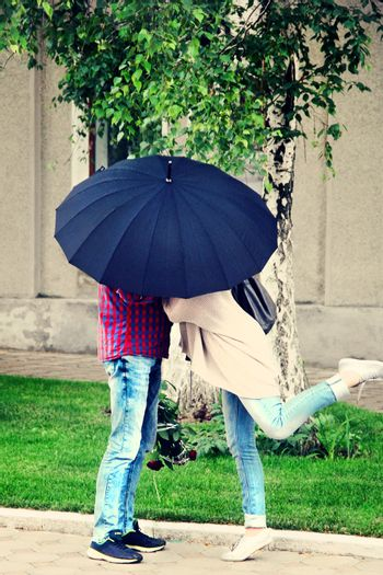 lovers unde an umbrella on a date. photo