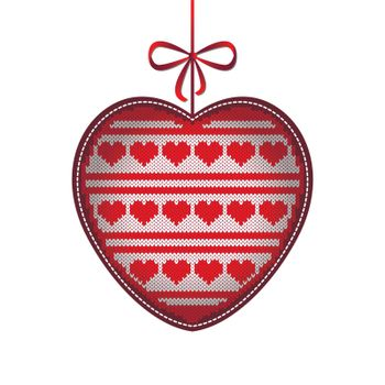 Valentines Day. Knitted volume heart. Pattern of hearts and stripes. White and red. Hanging on a string with a bow