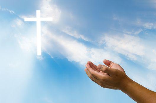 Pray for God's blessing Cross on natural background