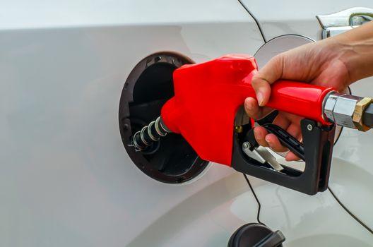 Fuel nozzle add fuel in car