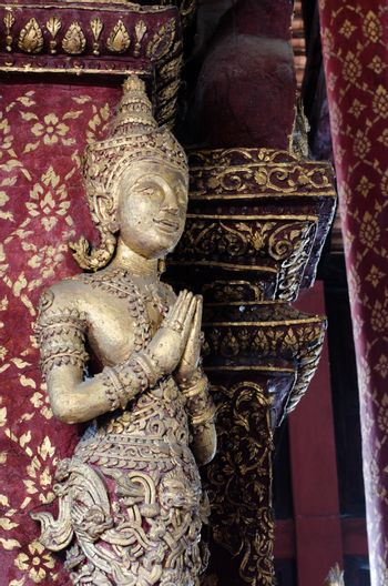 Buddha statue in front of places of worship is the worship of Buddhist.