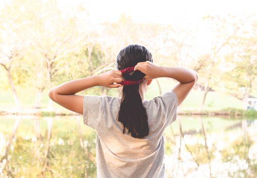 Girl poses a bundle of hair.