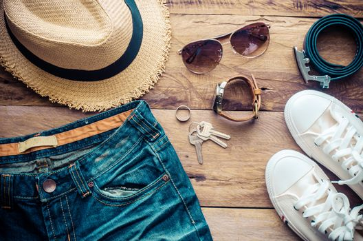 accessories for travel on wood floor- tone vintage