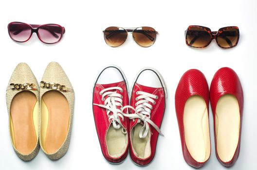 Placed shoes and sunglasses on a white background styles - lifestyles