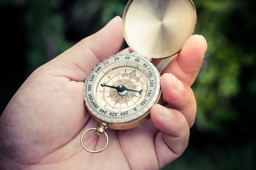 Compass in hand, tourists