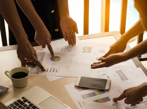 business team analysis with financial graph at office, workplace