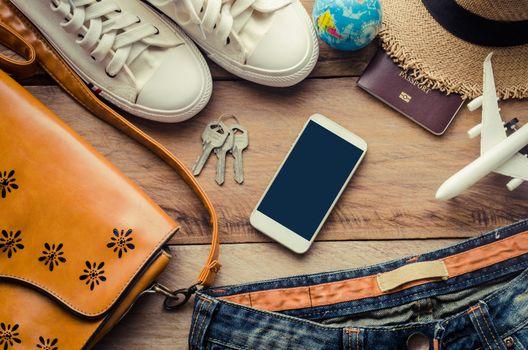 Travel accessories costumes on wooden floor