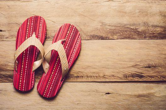 Red slipper on wooden