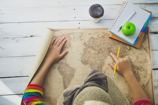 Traveler finding location for travel on the world map