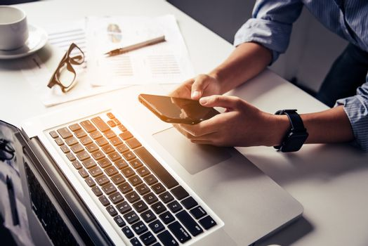 Businesses work through smartphones and laptop in the workplace