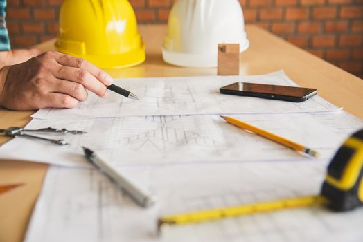 engineer working in office with blueprints, inspection in workpl