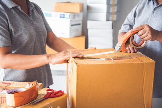 Team staff packed in brown boxes to deliver to customers