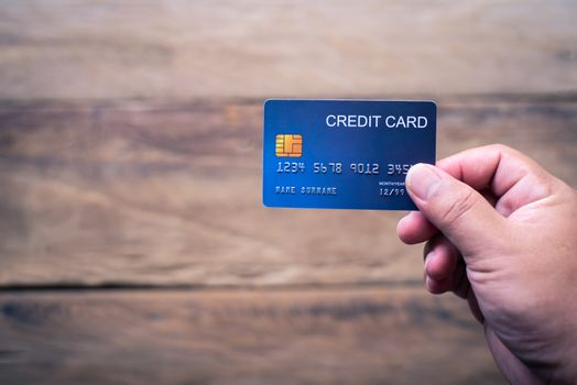 Hand holding a credit card make purchases online and conduct fin