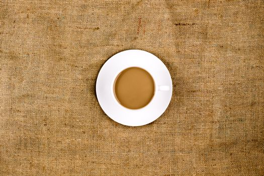 Coffee on a brown, structured background