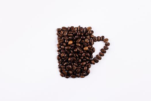 A mug of coffee beans