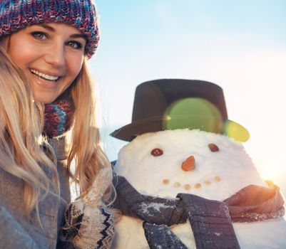 Portrait of a young woman with snowman
