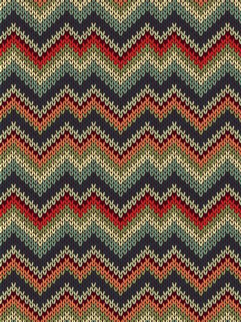 Multicolor seamless knit pattern. Zigzag embroidery texture.