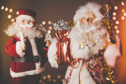 Father Frost and Santa Klaus figurines together, New Year 2019