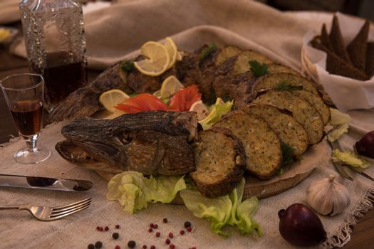 Stuffed pike with vegetables and greens. Russian food