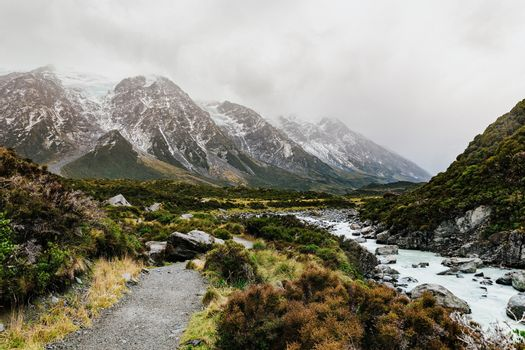 Hooker Valley Track hiking trail, New Zealand. View of Aoraki Mount Cook National Park with snow capped mountains.