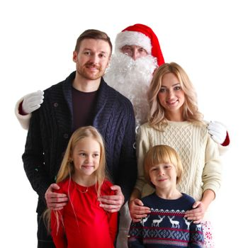Portrait of young family with two children with Santa Claus, isolated on white background