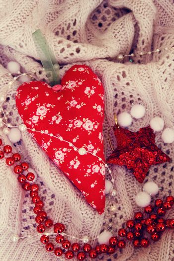 textile handmade toy heart for Christmas. Photo