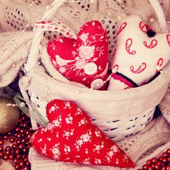 textile handmade toys three hearts for Christmas. Photo