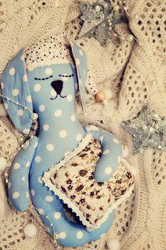 textile big hare or rabbit sleeping. photo