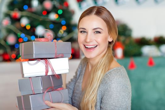 Cheerful female with Christmas gifts