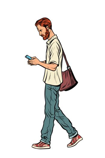 Bearded male pedestrian looks at a mobile phone