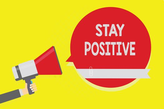 Handwriting text Stay Positive. Concept meaning Engage in Uplifting Thoughts Be Optimistic and Real Man holding megaphone loudspeaker red speech bubble yellow background