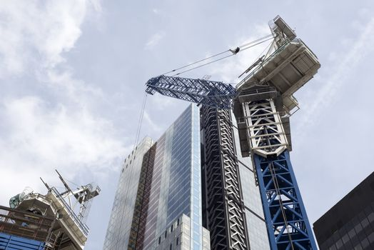 the construction of a london city skyscraper with a crane