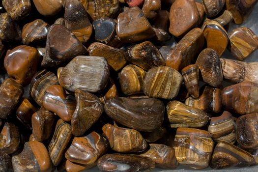 tiger's eye and hawk's eye gemstone as natural mineral rock specimen