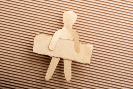 Paper man shape holding burnt note paper in hand