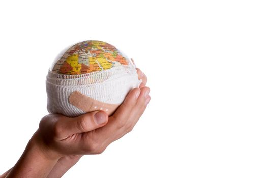 Child holding a globe with plaster in his hand on a white background