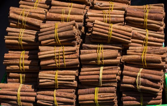 Stack of  of Cinnamon sticks in view as  background