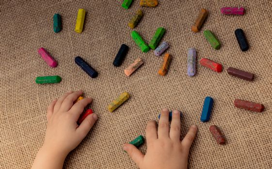Used  color crayons and a toddlers hand holding one