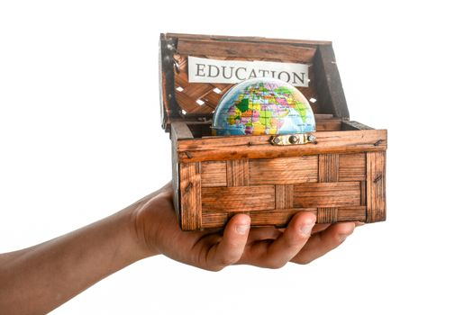 education sign and a globe in a chest box on a white background