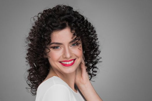 Smiling curly hair woman