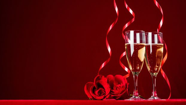 Romantic Celebration Of Valentine's Day With Champagne Wine And red Roses , red background with copy space