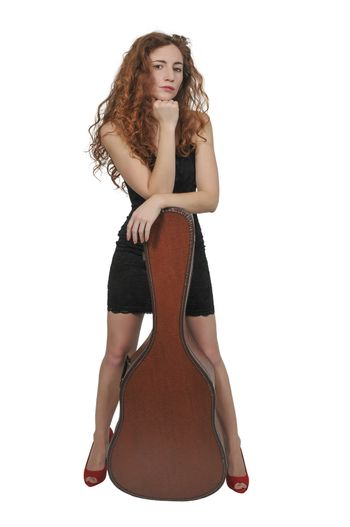 Beautiful young woman with a acoustic guitar case