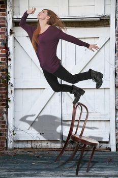 Beautiful woman as she slips trips and falls