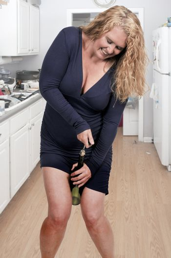 Beautiful middle age woman holding a bottle of wine