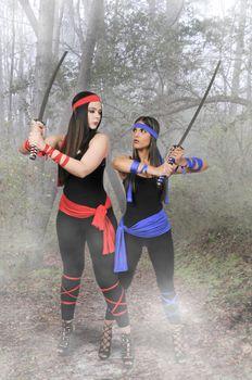 Young women with samurai bushido katana swords