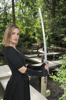 Young woman with a samurai bushido katana sword