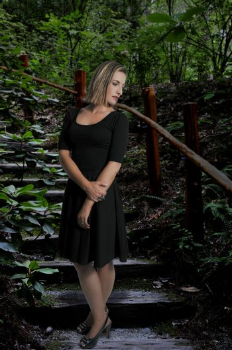 Beautiful sexy woman in a little black dress