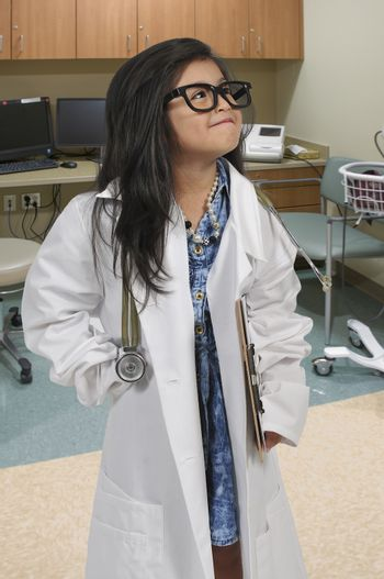 Cute little girl doctor on her rounds