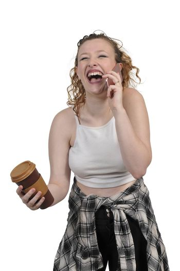 Beautiful woman using a cell phone will holding coffee
