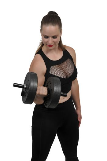 Beautiful young woman using weights during a workout